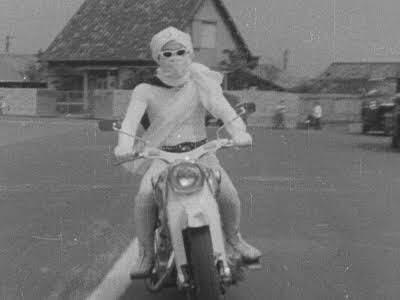月光仮面 with a motorcycle